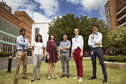 Six medical students from a range of different cultural backgrounds standing together on the campbelltown campus lawn