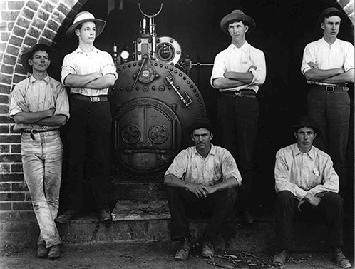Dairy Factory (interior): Students sitting in front of boiler (Print 1 of 2) [Hawkesbury Agricultural College (HAC)] c.1910 (P2108)