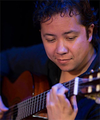 Photo of Alejandro Miranda playing the guitar