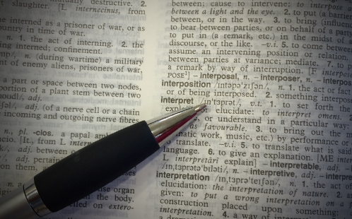Pen pointing to the word ''interpret