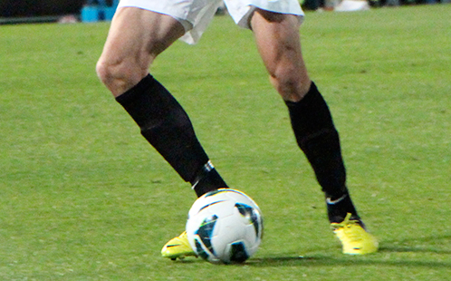 Player and a soccer ball