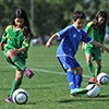 A thumbnail image of children playing soccer