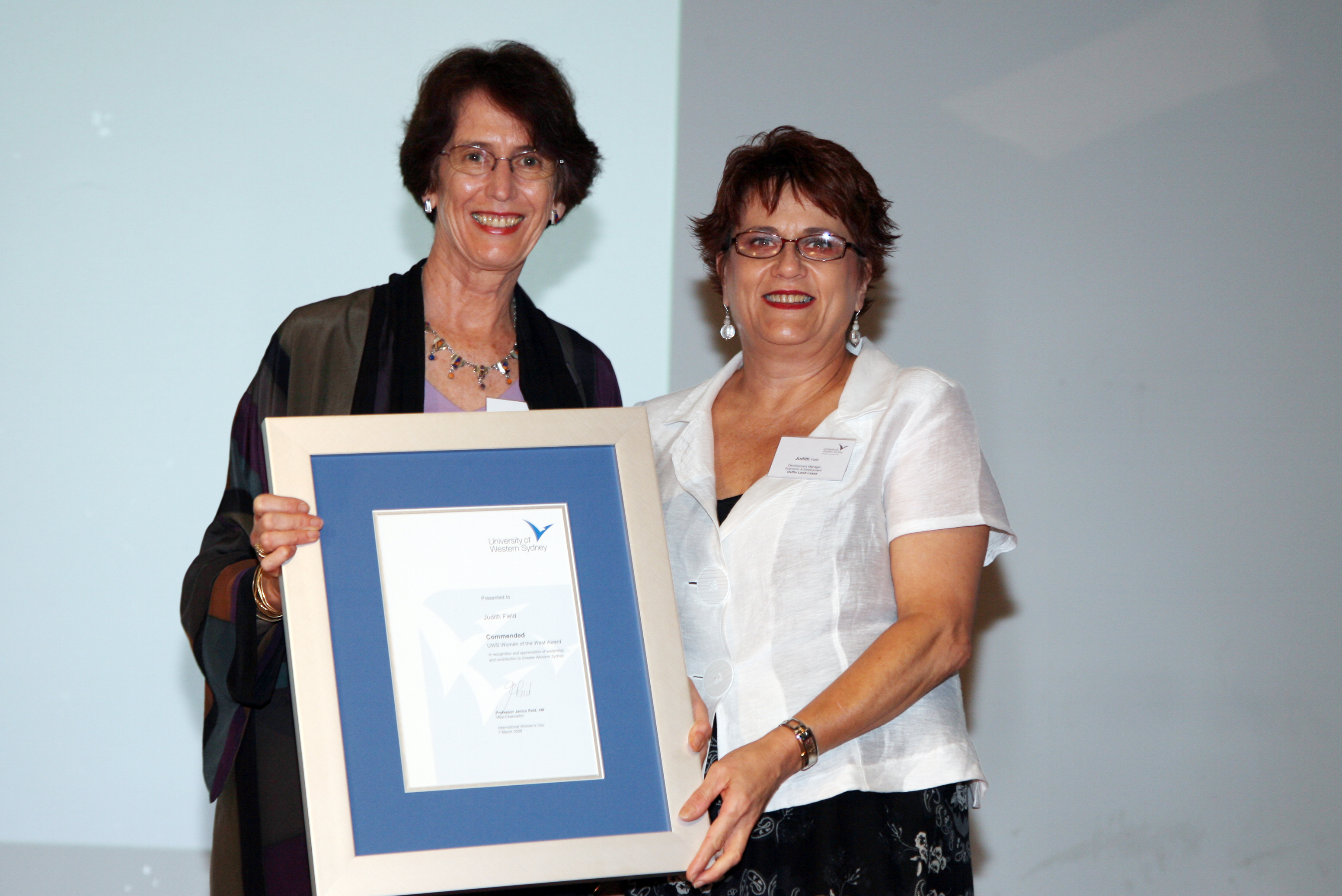 Vice-Chancellor Professor Janice Reid AM presents Judith Field with the Commended Award.