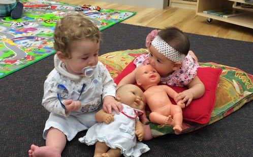 Babies play with dolls