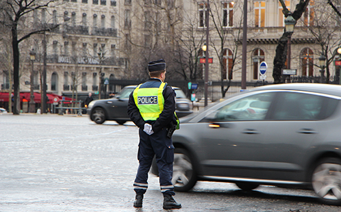 Paris policeman standing in traffic