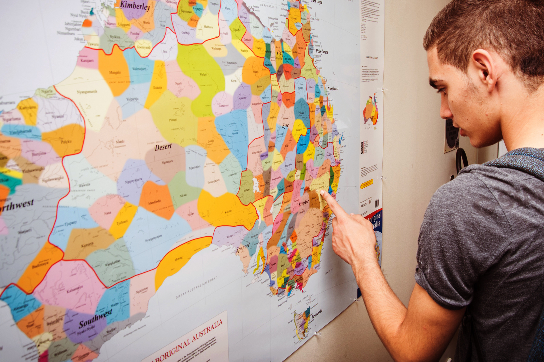 A student interacting with a colourful map of rural Australia