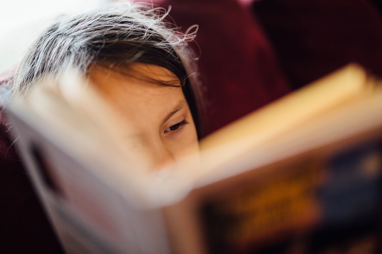 Child Reading A Book